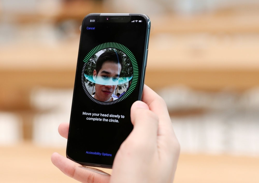 A customer sets his new iPhone's Face ID after purchase. Although the technology has been around for a while, with the new iPhone, it will be more common.