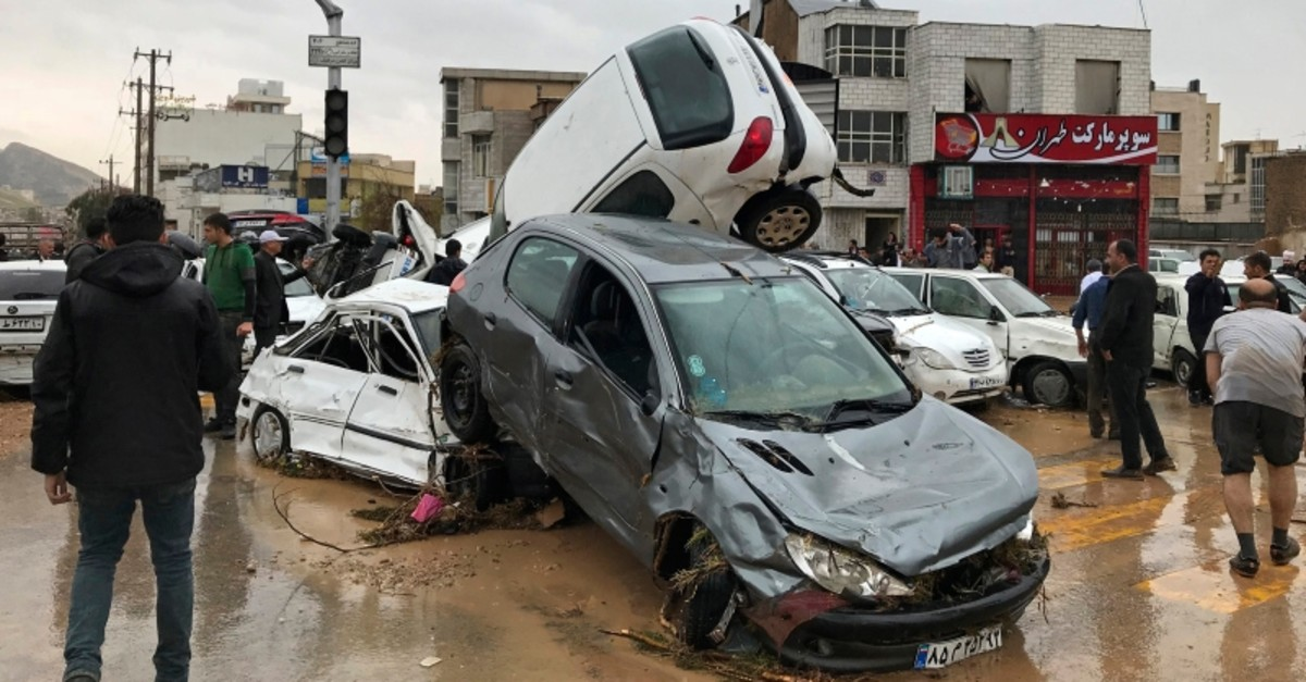 Vehicles are piled up on a street after a flash flood in the southern city of Shiraz, Iran, Monday, March 25, 2019. (AP Photo)
