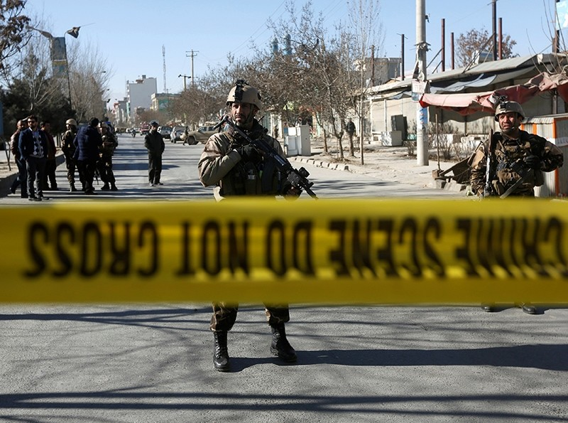 Afghan security forces keep watch at the site of a suicide attack in Kabul, Afghanistan, Dec. 28, 2017. (Reuters Photo)