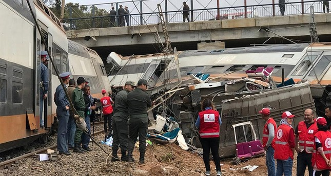 Aid workers gather at the site of train derailment at Sidi Bouknadel near the Moroccan capital Rabat, Morocco, Oct. 16, 2018. (Reuters Photo)