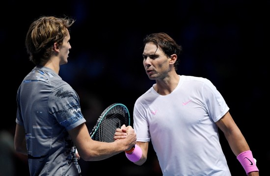 Germany's Alexander Zverev with Spain's Rafael Nadal after winning their group stage match. (Reuters Photo)