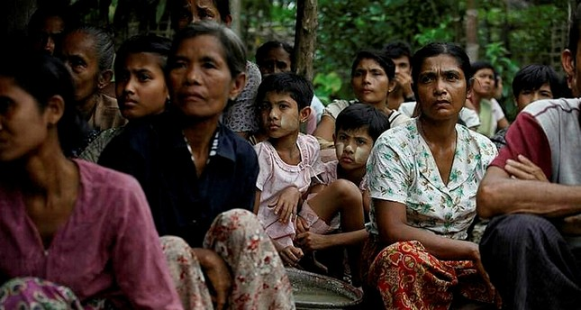 Rohingya Muslims sit in a temporary refugee camp after losing their homes during the violence in Thapyuchai village in the Rakhine state.