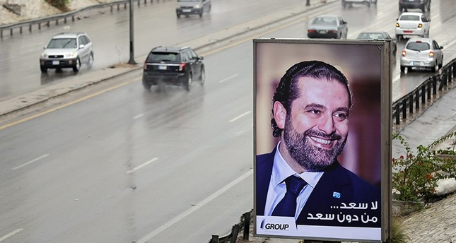 A poster bearing a portrait of Lebanese Prime Minister Saad Hariri reads in Arabic There is no hapiness without Saad is seen on a billboard on Beirut's airport highway, on November 21, 2017 (AFP Photo)