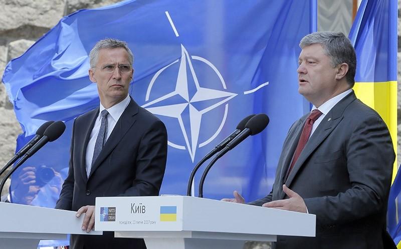 Ukrainian President, Petro Poroshenko, right, and NATO Secretary General Jens Stoltenberg attend a joint press conference in Kiev, Ukraine, Monday, July. 10 (AP Photo)