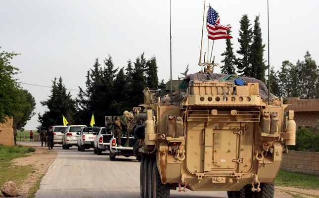 An U.S.-led coalition convoy in a YPG-held area in northern Syria.