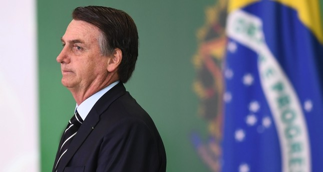 Brazilian President Jair Bolsonaro gestures during a ceremony in which some of the ministers of his cabinet take office a day after the swearing-in of the country's new government, at Planalto Palace in Brasilia, on January 2, 2019. AFP Photo