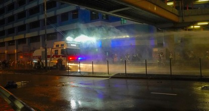 Hong Kong police fire water cannon at protesters