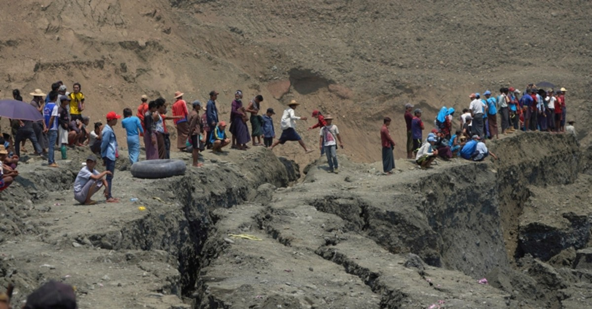 Local people look on in a jade mine where the mud dam collapsed in Hpakant, Kachin state, Myanmar April 23, 2019. (Reuters Photo)