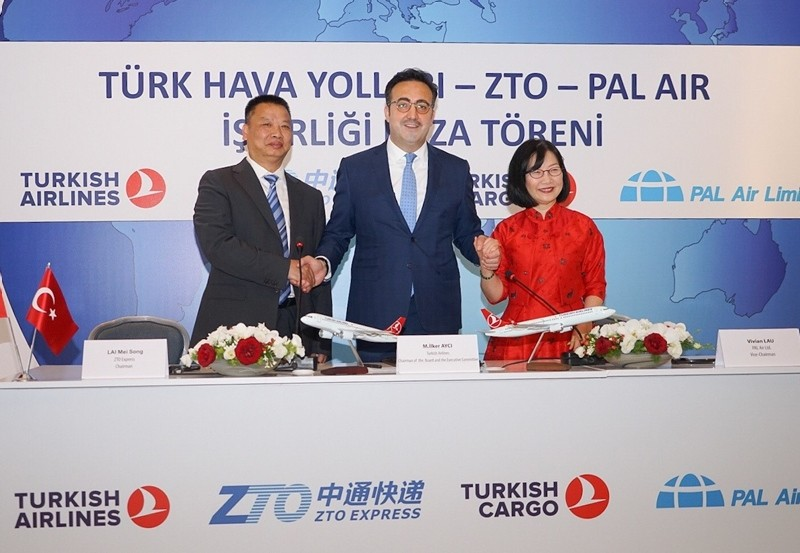 THY Chairman u0130lker Aycu0131, ZTO Express Chair Mei Song Lai and PAL Air Vice Chairman Vivian Lau join hands for a photo at the partnership deal signing ceremony in Istanbul, June 11, 2018. (AA Photo)