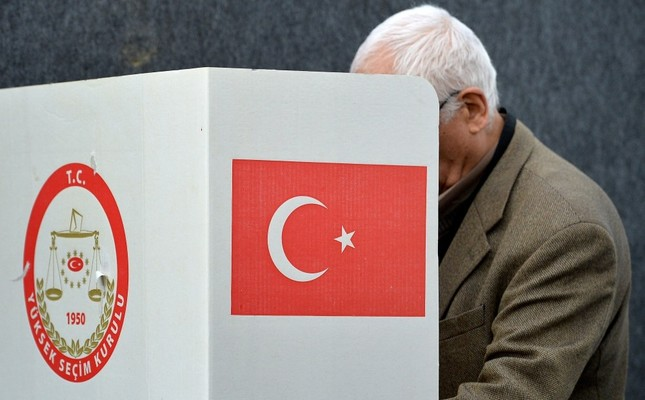 A man casting his vote for the Turkish referendum, at the Turkish Consulate in Geneva, Switzerland, March 28.