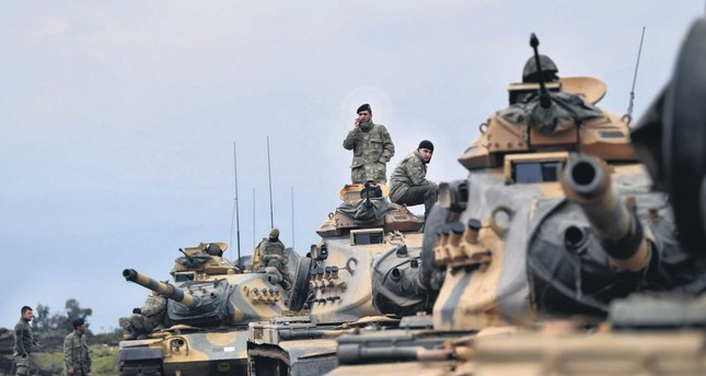 Turkish soldiers with tanks as they wait near the Syrian border before entering Syria for the Afrin operation, Hassa, Hatay, Jan. 21.