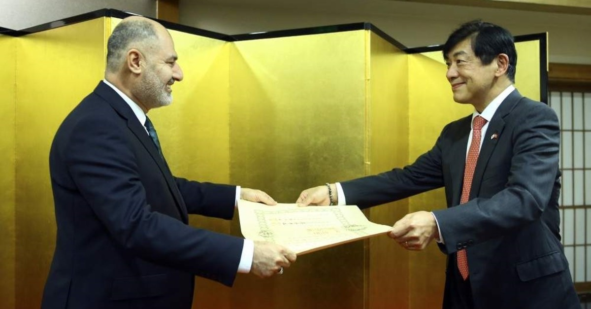 Japan's ambassador to Ankara, Akio Miyajima awards Deputy Defense Minister Alpaslan Kavakl?o?lu for his contributions in enhancing Turkey-Japan relations on Dec.19, 2019 (AA Photo)
