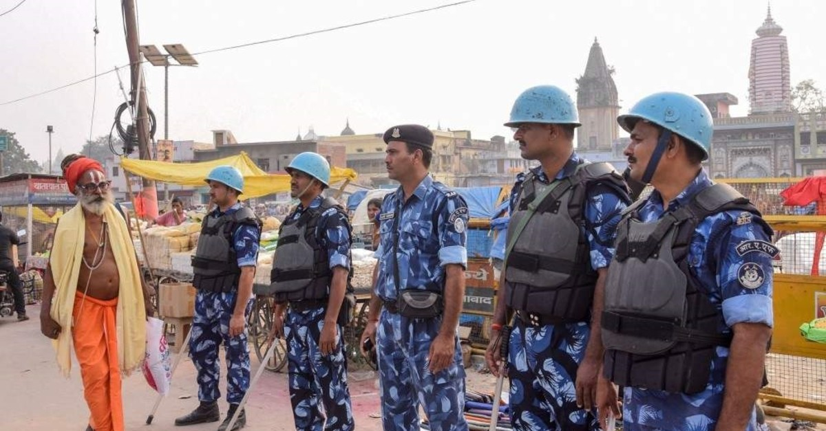 Security personnel stand guard on a street in Ayodhya on Nov. 07, 2019, as part of a security measure ahead of a Supreme Court verdict (AFP Photo)