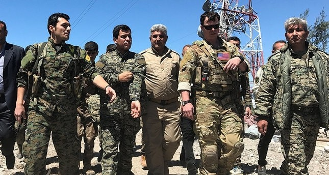 The photo, which was widely shared on social media, shows PKK terrorist Abdi Ferhad Şahin (2nd-Left) seen with a U.S. soldier in northern Syria.