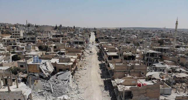 An aerial view shows buildings destroyed by Syrian regime attacks in the town of Khan Sheikhun in the southern countryside of Idlib, Aug. 4, 2019.