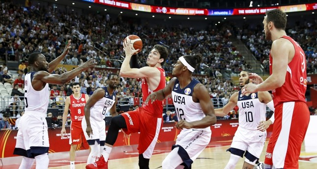 Myles Turner (C-R) of the USA in action against Cedi Osman (C-L) of Turkey during the U.S.-Turkey game in Shanghai, Sept. 3 2019.