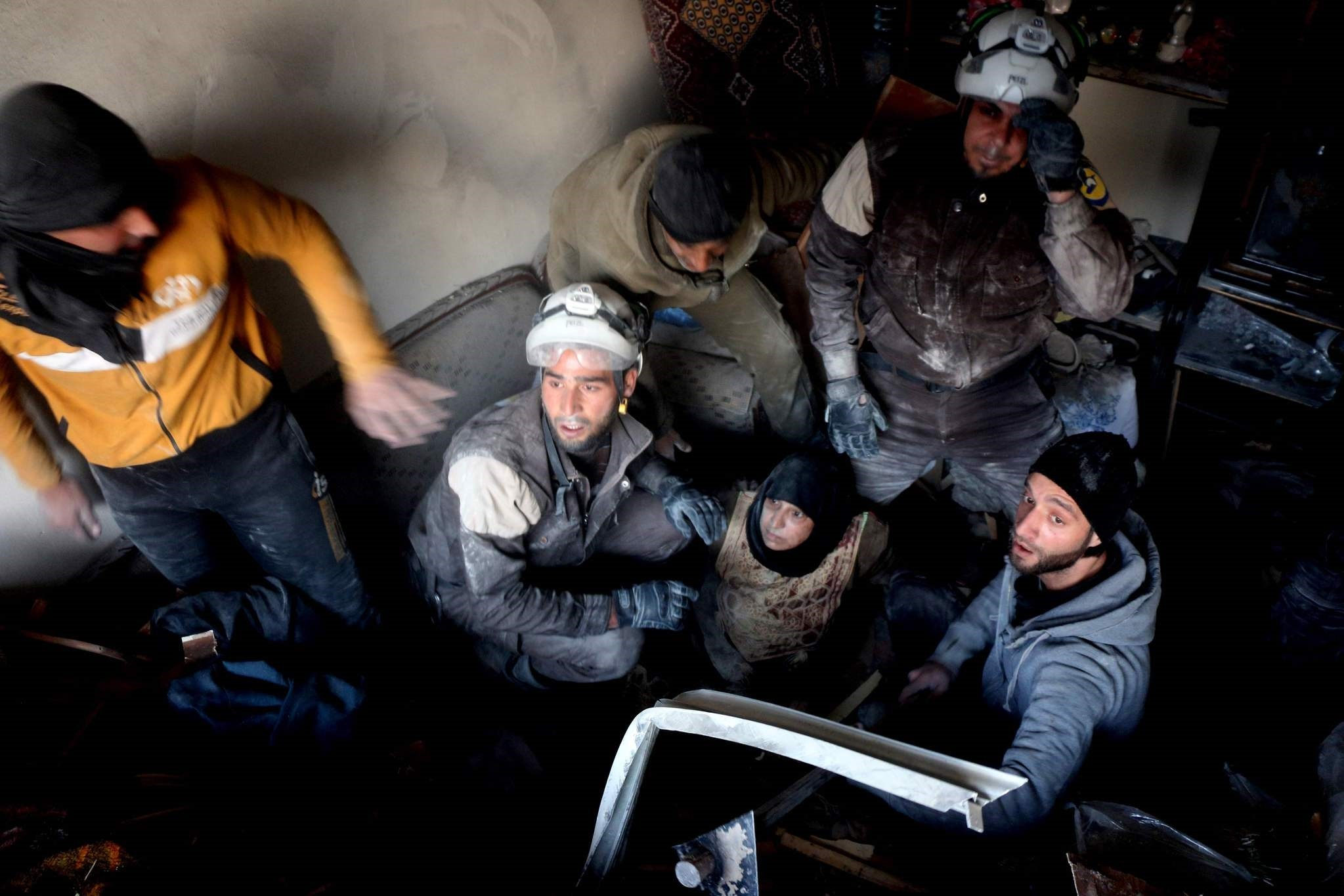 This file photo taken on November 20, 2016 shows Syrian civil defence volunteers, known as the White Helmets, helping a victim. (AFP Photo)