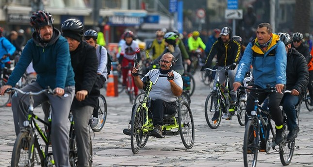 Cyclists tour Izmir on Dec. 2, 2018, to raise awareness on International Day of Persons with Disabilities. (AA Photo)