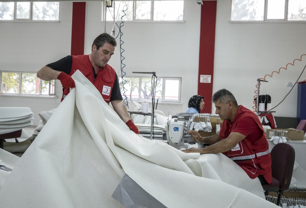 Workers sew tents at Red Crescent's factory in Ankara's Etimesgut district.