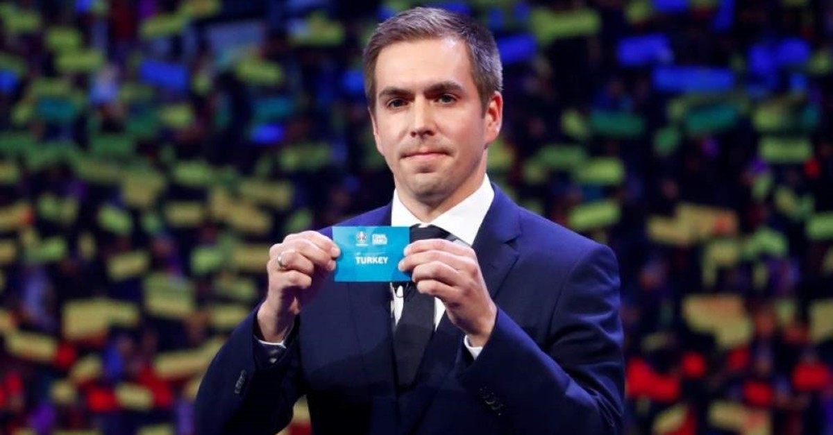 Turkey is drawn out by Philipp Lahm. (Reuters Photo)