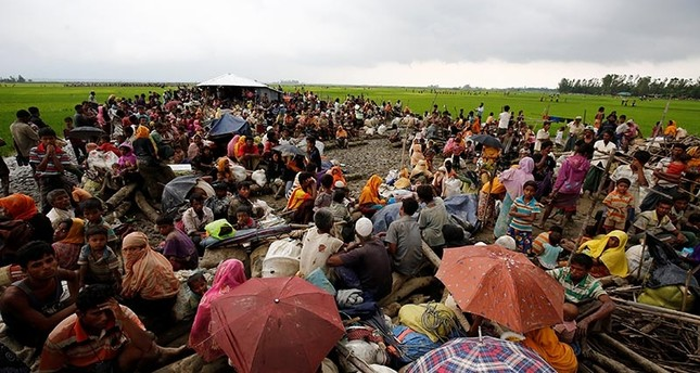 Rohingya refugees sit as they are temporarily held by the Border Guard Bangladesh (BGB) in an open area after crossing the border, in Teknaf, Bangladesh, September 3, 2017 (Reuters Photo)