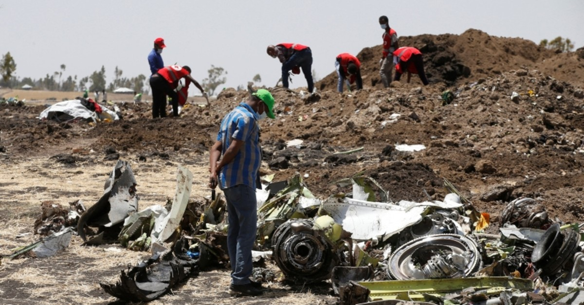 A man watches debris at the scene of the Ethiopian Airlines Flight ET 302 plane crash, near the town of Bishoftu, southeast of Addis Ababa, Ethiopia March 12, 2019. (REUTERS Photo)