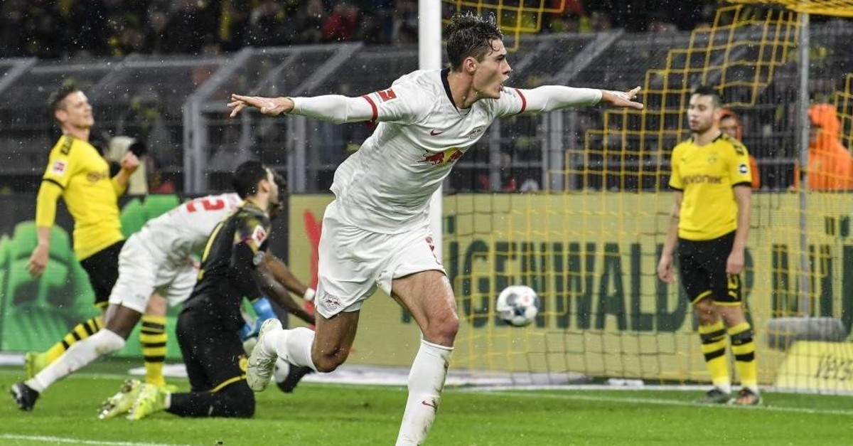 Leipzig's Schick celebrates after scoring his side's third goal during the match against Borussia Dortmund, Dec. 17, 2019. (AP Photo)
