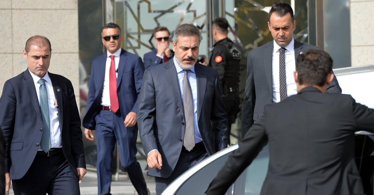 Hakan Fidan (C) has been the target of FETu00d6 since his appointment. (Photo by Ali Ekeyu0131lmaz)