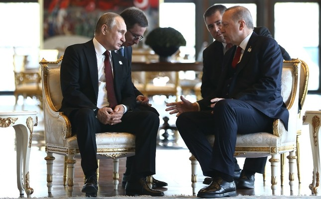 President Recep Tayyip Erdoğan and his Russian counterpart Vladimir Putin L during a talk ahead of the inauguration ceremony of the Akkuyu Nuclear Power Plant Project, Ankara, April 3, 2018.