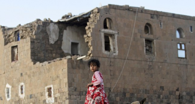 A girl walks by her house in Faj Attan village, which was destroyed in an airstrike carried out by the Saudi-led coalition, Sanaa, Yemen, Dec. 13.