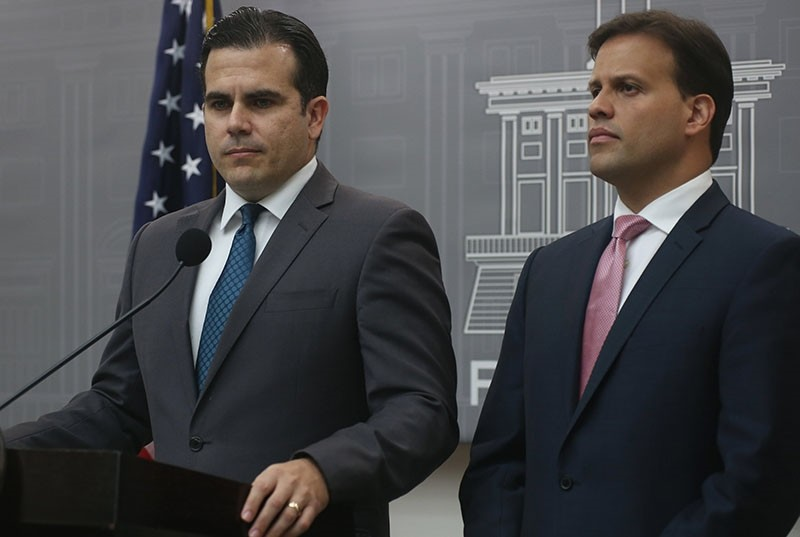 The Governor of Puerto Rico, Ricardo Rossello Nevares (L) and Representative to the Fiscal Supervision Board (JSF), Elias Sanchez (R), address a press conference at La Fortaleza de San Juan, in San Juan, P. Rico, May 03, 2017. (EPA Photo)