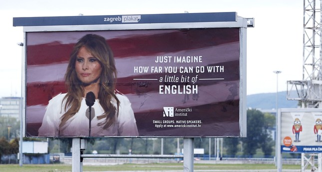 Photo shows a billboard ad for the American Institute school in Zagreb featuring an image of Melania Trump with a caption that reads, Just imagine how far you can go with a little bit of English. (AFP Photo)