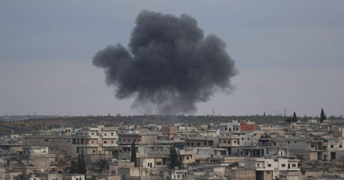 Smoke billows following reported bombardment by Syrian regime forces on the town of Kafr Ruma on the outskirts of Maaret al-Numan, in the northwestern Syrian province of Idlib, Jan. 27, 2020. (Photo by Omar HAJ KADOUR / AFP)