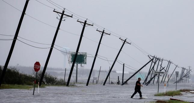A man walks through flood on Aug. 26 in Rockport, Texas. (Reuters Photo)