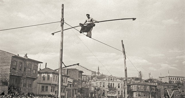 Two acrobats in Little Hagia Sophia neighborhood, Fatih, Istanbul, around 1930. Yapi Kredi Historical Archive.