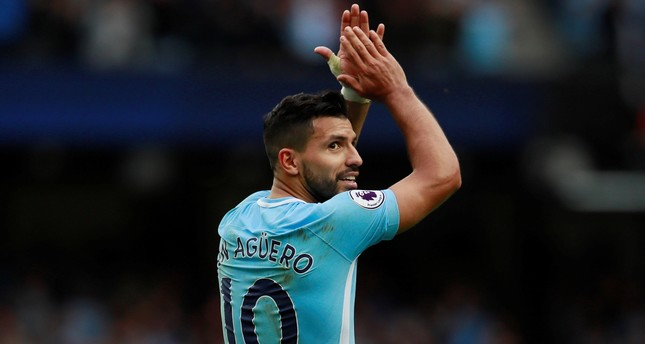 Sergio Aguero (L) celebrates after scoring during the English Premier League football match between Manchester City and Crystal Palace in Manchester, on September 23, 2017. (REUTERS Photo)