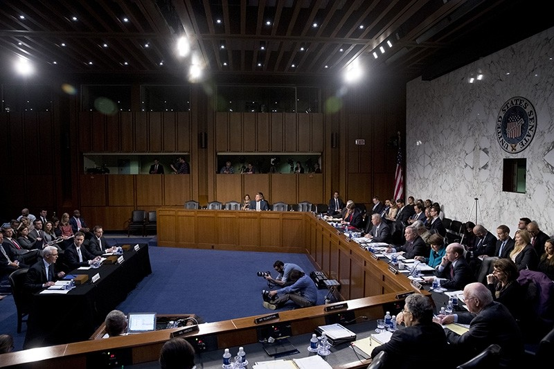 At left, Facebook's General Counsel Colin Stretch, accompanied by Twitter's Acting General Counsel Sean Edgett, and Google's Law Enforcement and Information Security Director Richard Salgado, speaks during a Senate Committee in Washington. (AP Photo)