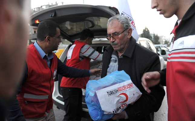 Turkish Red Crescent delivering humanitarian aid to the people of Gaza in 2013. Photo by Kutup Dalgakıran