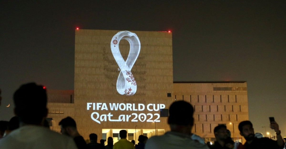 Qataris gather at the capital Doha's traditional Souq Waqif market as the official logo of the FIFA World Cup Qatar 2022 is projected on the front of a building on September 3, 2019. (AFP Photo)