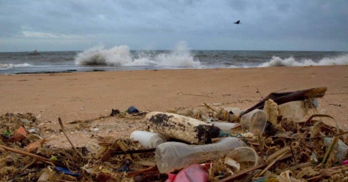 In this Aug. 13, 2015, file photo, a plastic bottle lies among other debris washed ashore on the Indian Ocean beach in Uswetakeiyawa, north of Colombo, Sri Lanka. (AP File Photo)