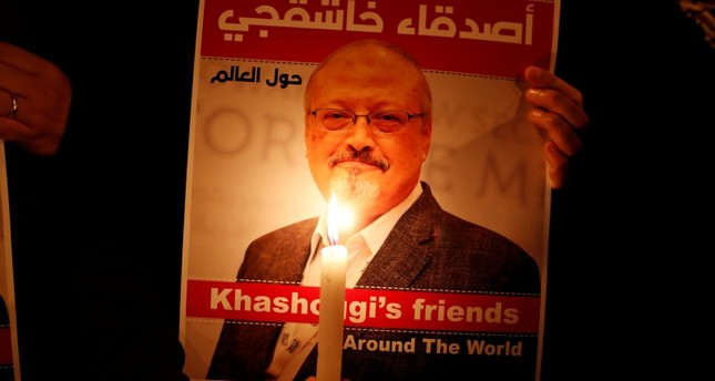 A demonstrator holds a poster with a picture of Saudi journalist Jamal Khashoggi outside the Saudi Arabia consulate in Istanbul, October 25, 2018. (REUTERS Photo)