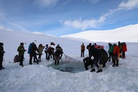 Daredevils dive into glacial lake, brave the cold