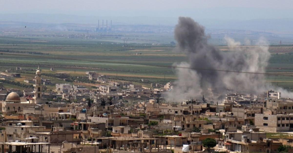 Smoke billows following intense shelling in Khan Sheykun in Syria's Idlib province, May 10, 2019.