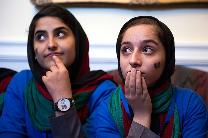 Afghanistan's FIRST Global Challenge team member Lida Azizi (L) and captain Fatemah Qaderyan meet with reporters following the opening ceremony in Washington, Sunday, July 16, 2017. (AP Photo)