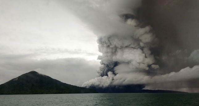 This Dec. 26, 2018 photo shows the Anak Krakatau volcano erupting, as seen from a ship on the Sunda Straits. (AFP Photo)