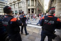 Spain's central government and regional Catalan authorities tussled Saturday over who controls the regional police force that is considered key to the success of a planned Oct. 1 independence vote...