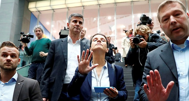 Frauke Petry (C), chairwoman of the anti-immigration party Alternative fuer Deutschland (AfD) reacts as she leaves a news conference in Berlin, Germany, September 25, 2017. (Reuters Photo)