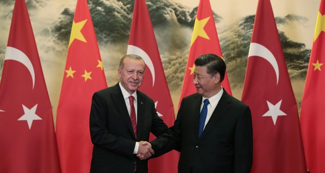 President Recep Tayyip Erdoğan and Chinese President Xi Jinping shake hands before a meeting on Turkey-China bilateral relations, Beijing, July 2, 2019.
