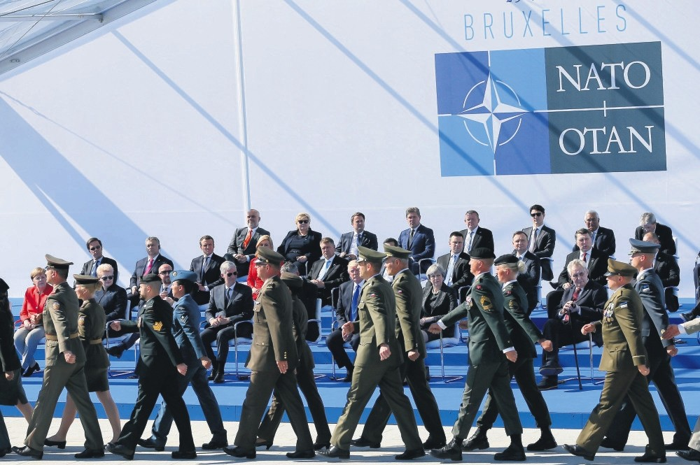 Head of NATO member states watch a march during the inauguration of the new NATO headquarters, Brussels, Belgium, May 25.