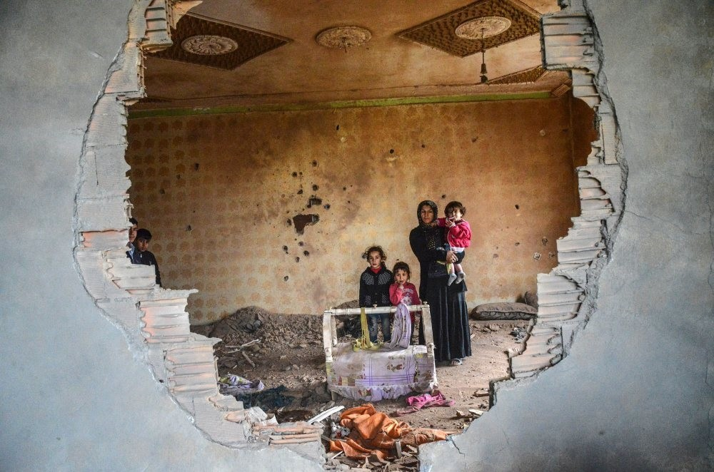 A woman and her children stand in the ruins of their house in Silopi, a town in u015eu0131rnak, in January 2016. The PKK's terror campaign left many displaced last year.